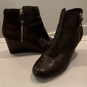 Brown wedge booties with gold hardware.